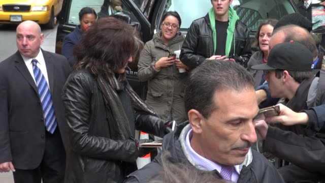 joe perry of aerosmith signs for fans outside of the late show in new york, ny, on 11/01/12 - エアロスミス点の映像素材/bロール