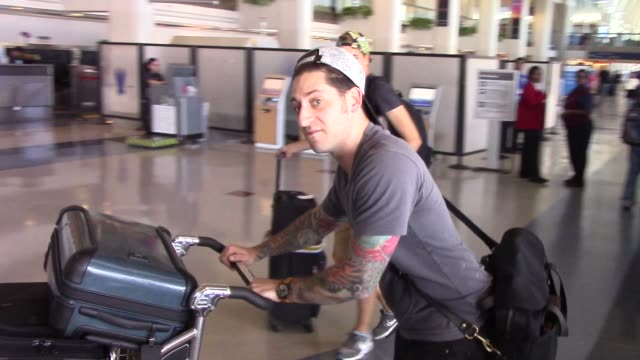 Joe Trohman from Fall Out Boy greets fans before departing at LAX Airport on August 14 2015 in Los Angeles California