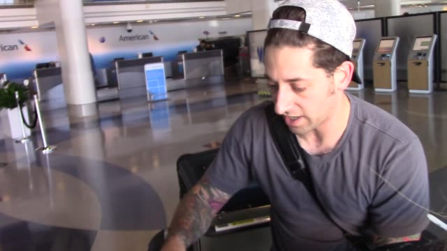 Joe Trohman of Fall Out Boy with fans at Los Angeles International Airport at Celebrity Sightings in Los Angeles on August 14 2015
