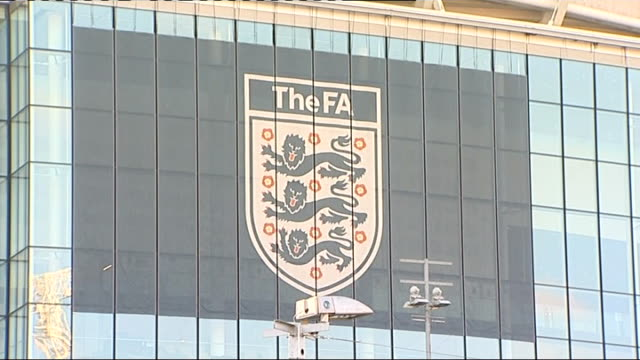 stockvideo's en b-roll-footage met joey barton banned for twelve matches; r03021214 / 3.2.2012 london: wembley stadium: large 'the fa' sign and logo on side of wembley stadium bobby... - english football association