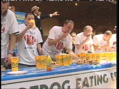 joey chestnut beats takeru kobayashi in the 2007 hot dog eating contest. - contestant stock videos & royalty-free footage