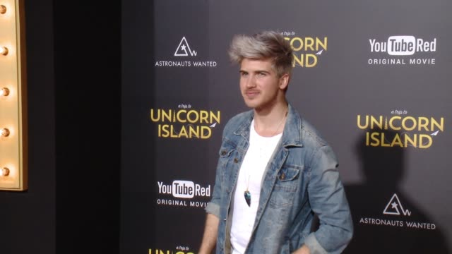 """joey graceffa at """"a trip to unicorn island"""" world premiere at tcl chinese theatre on february 10, 2016 in hollywood, california. - joey graceffa stock videos & royalty-free footage"""