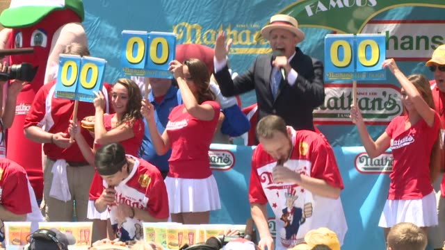 wpix joey jaws chestnut scarfed down 70 hot dogs in 10 minutes at nathan's famous hot dog eating contest in coney island on july 4 2016 to break his... - hot dog stock videos & royalty-free footage