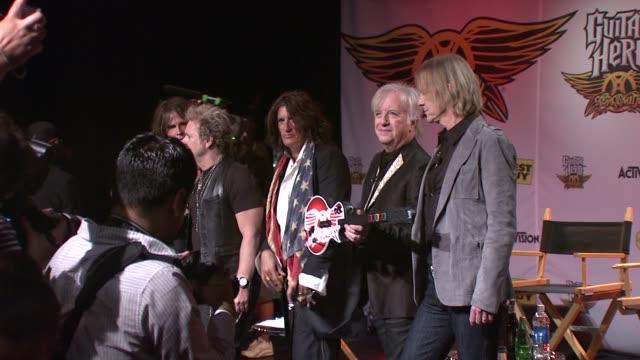 joey kramer, joe perry, brad whitford and tom hamilton at the aerosmith launches new guitar hero at new york ny. - エアロスミス点の映像素材/bロール