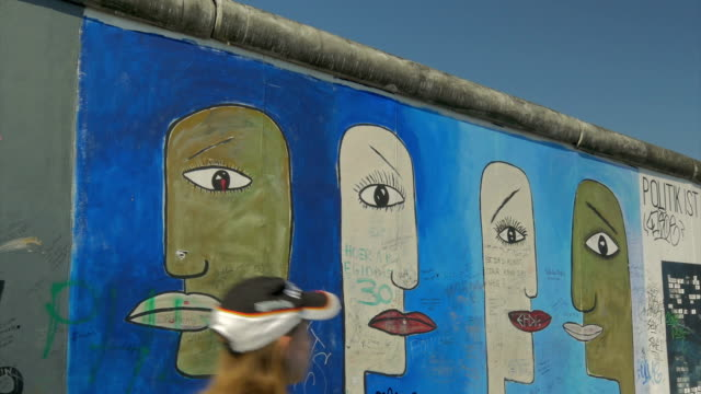 Jogger in front of  Berlin Wall, Grafitti, Murals,