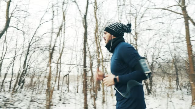 jogger in winter season. - wearable computer stock videos & royalty-free footage