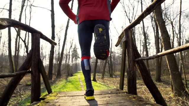 HD SUPER SLOW-MO: Jogger On The Footbridge