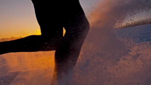 SLO MO Jogger Trudging Through The Snow At Sunset