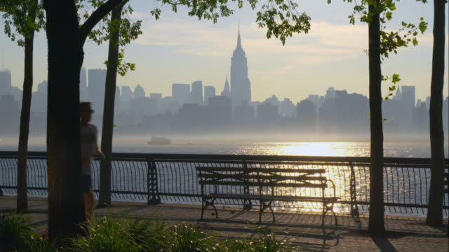 Joggers in front of Empire State Building in early morning hours.