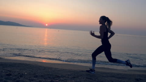 jogging after sunset. beach holiday - seascape stock videos & royalty-free footage