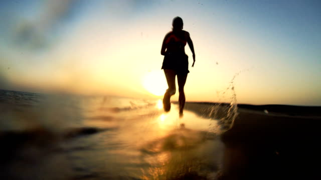 jogging after sunset. beach holiday - femininity stock videos & royalty-free footage