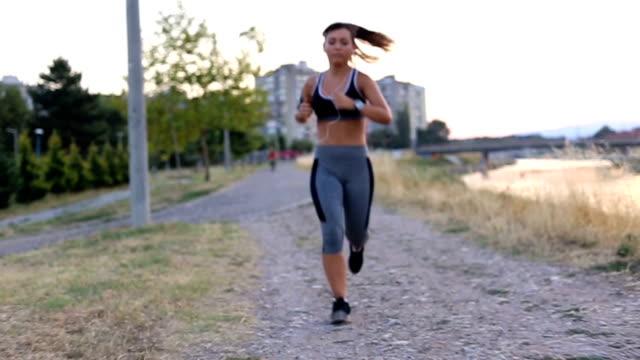 Jogging at summer sunset