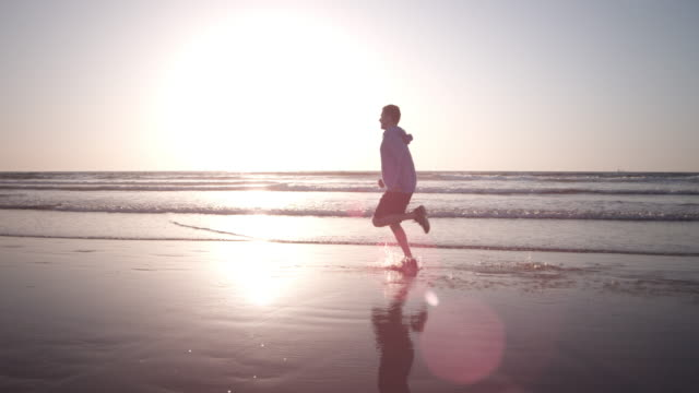 jogging at the beach - only men stock videos & royalty-free footage