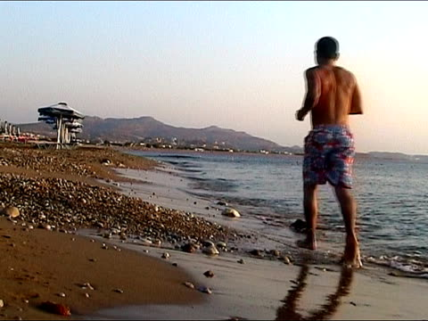 jogging at the beach - human limb stock videos & royalty-free footage