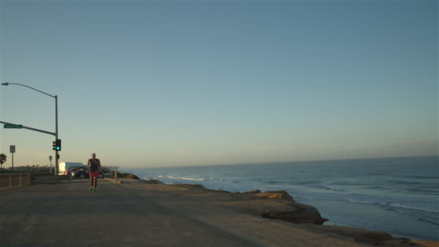 Jogging by the coast (Wide shot)