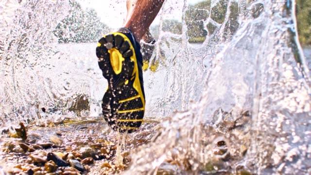 slo mo jogging in a shallow water - recreational pursuit stock videos & royalty-free footage