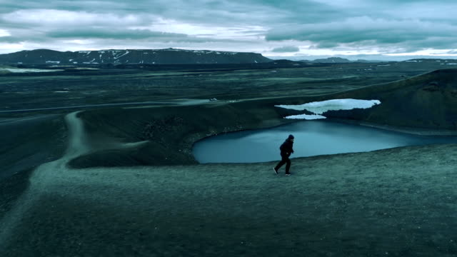 jogging in extreme terrain. crater lake - at the edge of stock videos and b-roll footage