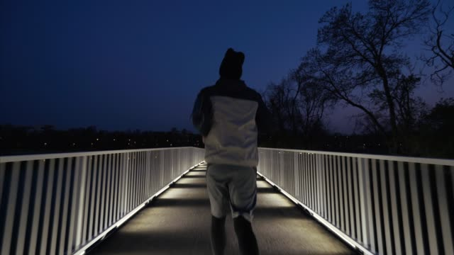 jogging in the evening. - endurance stock videos & royalty-free footage