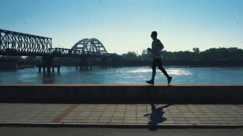 jogging in the morning. - riverbank stock videos & royalty-free footage