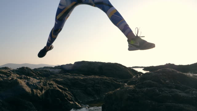 jogging on a rocky shore. after sunset - slim stock videos & royalty-free footage