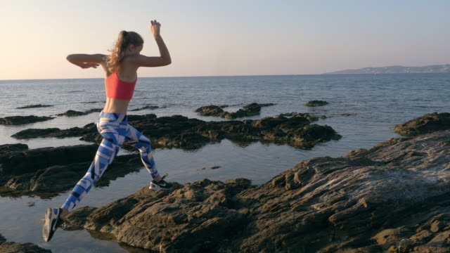 jogging on a rocky shore - sports activity stock videos & royalty-free footage