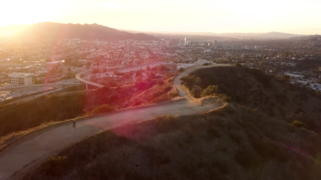 Jogging on Southern California Mountain Trail - Aerial Drone Shot