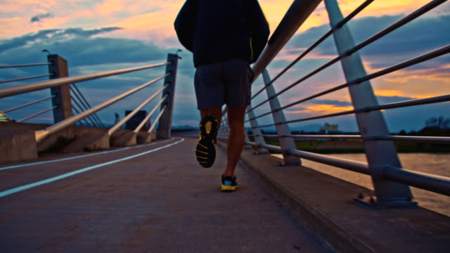TS Jogging On The Bridge At Dusk