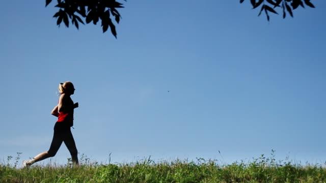 vídeos y material grabado en eventos de stock de jogging - corredora de footing