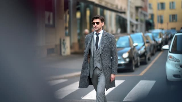 Johannes Huebl wears a gray suit a tie sunglasses during Milan Menswear Fashion week Fall/Winter 2018/19 on January 14 2018 in Milan Italy