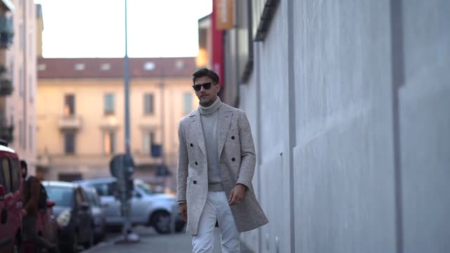 johannes huebl wears sunglasses a gray wool turtleneck pullover a wool coat white pants brown shoes outside marni during milan fashion week... - marni stock videos & royalty-free footage