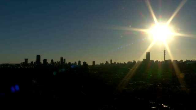 ws ha johannesburg city skyline with lens flare  / johannesburg/ south africa - image stock videos & royalty-free footage