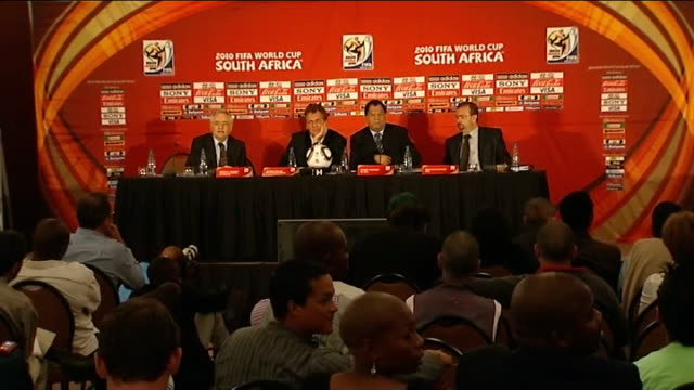 jerome valcke holding up article at presser danny jordaan press conference sot - fifa world cup 2010 stock videos & royalty-free footage