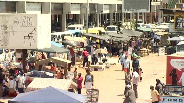 johannesburg pretoria and kwa thema township traffic along / backs of market stalls / advertising poster / back of market area / poster / stall... - pretoria stock videos & royalty-free footage