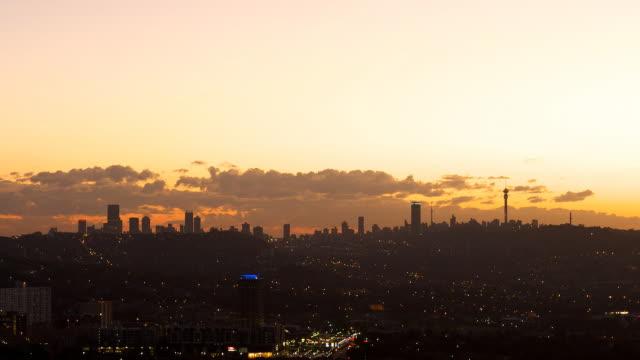 T/L Johannesburg skyline lighting up at night, South Africa