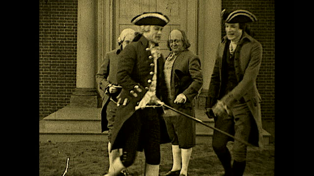"""john adams talking to benjamin franklin in front of independence hall: """"that building will live in history as the birthplace of a new power among the... - benjamin franklin stock videos & royalty-free footage"""