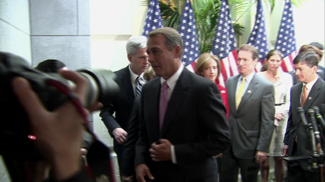 vidéos et rushes de john boehner talks about preventing lowering government spending and bringing down the national debt on the eve of an impending government shutdown. - finances personnelles