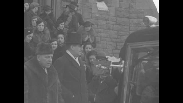 ms john buchan governor general of canada lord tweedsmuir stands in doorway and salutes with wife susan beside him / dignitaries and others stand... - john buchan stock videos & royalty-free footage
