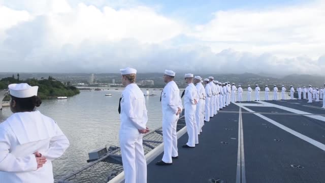 uss john c stennis rendered honors to the uss arizona during arrival to joint base pearl harborhickam john c stennis is underway to conduct routine... - 米国海軍点の映像素材/bロール