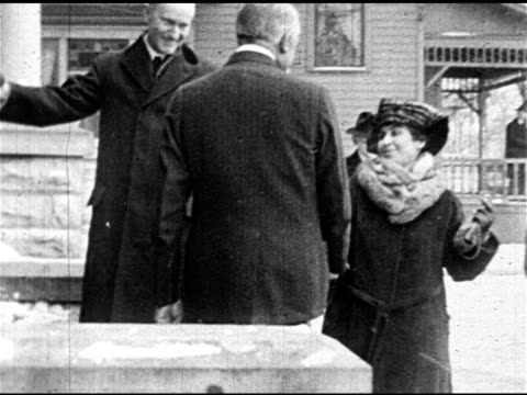 john calvin coolidge jr wife grace in heavy coats walking up to harding home shaking hands w/ warren ha ws calvin coolidge florence harding grace... - coolidge calvin stock videos & royalty-free footage