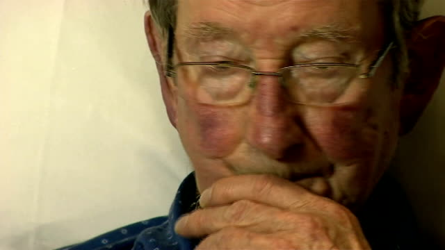 john cantlie held hostage by islamic state father's appeal england paul cantlie in hospital bed as nurse adjusts drip line going into the arm of paul... - machine valve stock videos & royalty-free footage