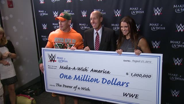 CHYRON John Cena And MakeAWish Celebrate His 500th Wish Granting Milestone at Dave Buster's Time Square on August 21 2015 in New York City