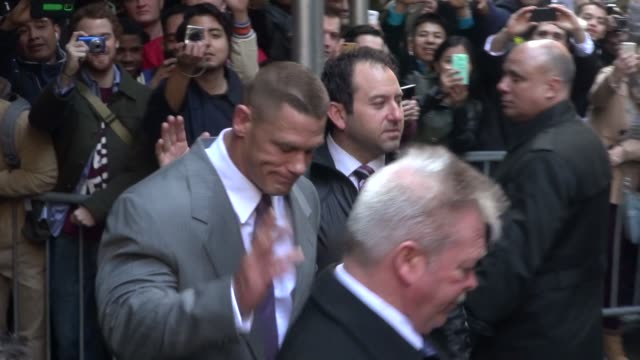 John Cena departs from the WWE Wrestlemania press conference at the Hard Rock Cafe on April 01 2014 in New York City