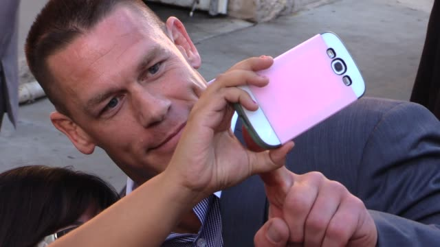 john cena greeting fans at the jimmy kimmel studio in hollywood in celebrity sightings in los angeles - cena stock videos & royalty-free footage