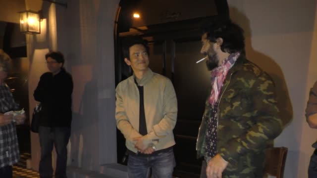 john cho signs autographs for fans outside craig's restaurant in west hollywood in celebrity sightings in los angeles, - autogramm stock-videos und b-roll-filmmaterial