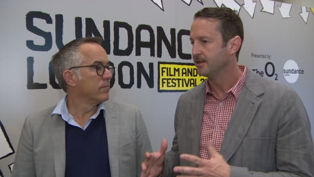 vídeos de stock, filmes e b-roll de interview john cooper trevor groth on growing the success of sundance london putting the program together how knowledgeable the london audience is... - festival de cinema de sundance
