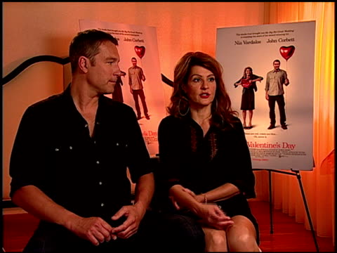 john corbett and nia vardalos on why she writes her own films and how she enjoyed writing for john at the 'i hate valentine's day' junket at los... - john corbett stock videos and b-roll footage