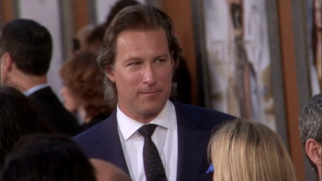 ws john corbett standing on crowded red carpet talking to unknown women - john corbett stock videos and b-roll footage