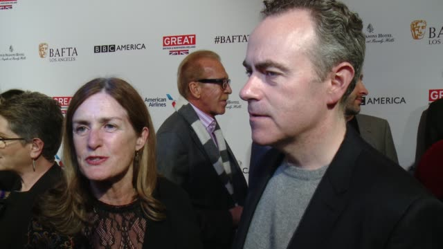 vídeos de stock, filmes e b-roll de interview john crowley and finola dwyer on being at the event and on why the film 'brooklyn' resonates with them at the bafta los angeles awards... - four seasons hotel