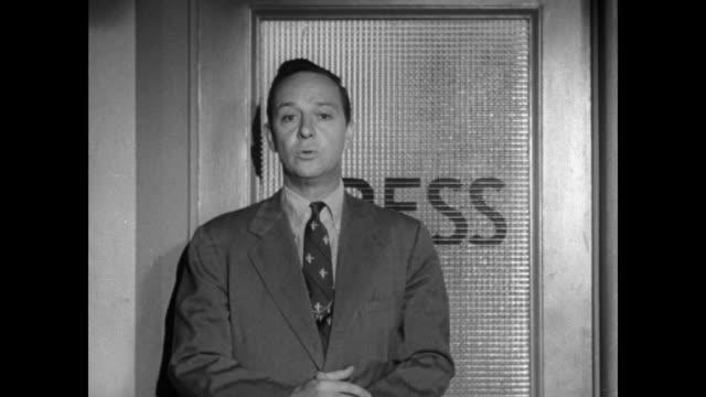 vídeos y material grabado en eventos de stock de john daly interviews reporters earl brown of life magazine and ed mowery of the new york world-telegram about the teenage drug problem. - 1951
