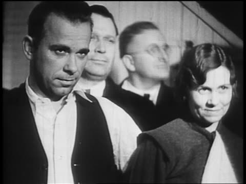 john dillinger posing with sheriff lillian holley / others in background - john dillinger stock-videos und b-roll-filmmaterial